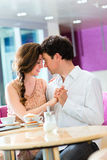 Young couple cafe hugging and kissing Stock Image