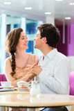 Young couple cafe hugging and kissing Stock Photos