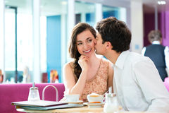 Young couple cafe hugging and kissing Royalty Free Stock Photos