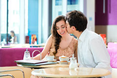 Young couple cafe hugging and kissing Royalty Free Stock Images