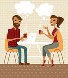 Young couple in a cafe. Young couple talking and drinking coffee in a cafe Royalty Free Stock Image