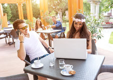 Young couple in the cafe terrace Stock Image