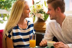Young couple in cafe. Enjoying the time in holiday Stock Photography