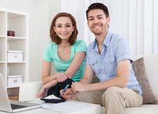Young couple calculating budget Royalty Free Stock Image