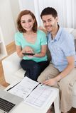 Young couple calculating budget Stock Photography