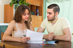Young couple calculating budget Stock Images