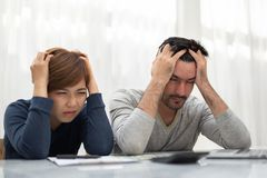 Young couple calculating their budget for new house. royalty free stock images