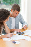 Young couple calculating their domestic bills Royalty Free Stock Photos