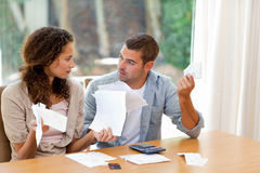 Young couple calculating their domestic bills Royalty Free Stock Photography