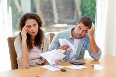 Young couple calculating their domestic bills Stock Images
