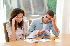Young couple calculating their domestic bills Stock Image