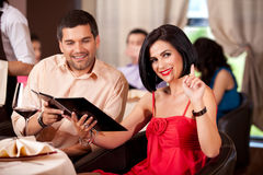 Young couple calling waiter restaurant table Royalty Free Stock Images