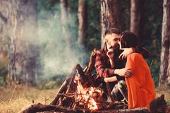Young couple with calm faces covered with plaid. royalty free stock photo