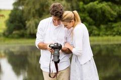 Young couple camera Stock Photos