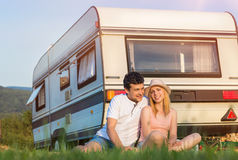 Young couple with a camper van Stock Photo