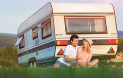 Young couple with a camper van Stock Photography