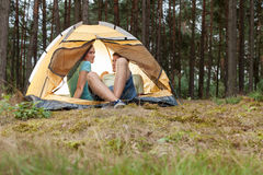 Young couple camping in forest Royalty Free Stock Photo
