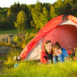 Young couple camping lying in tent Royalty Free Stock Image