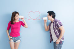 Young couple with can phone Royalty Free Stock Photos