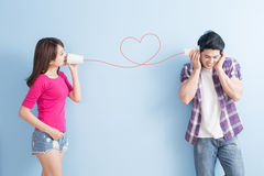 Young couple with can phone Royalty Free Stock Image