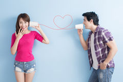 Young couple with can phone Royalty Free Stock Photography