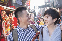 Young couple with candied haw. Royalty Free Stock Photos