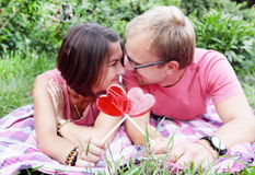Young Couple with Candy Hearts on Picnic Royalty Free Stock Photos