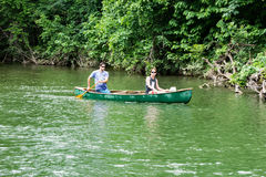 Young Couple Canoeing on the Roanoke River Royalty Free Stock Photo