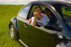 Young couple in car. A young couple making a rude gesture at the camera Royalty Free Stock Photo