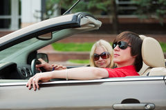 Young man and woman driving a car Royalty Free Stock Photo