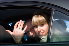 Young couple in the car Royalty Free Stock Image