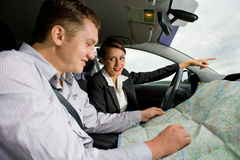 Young couple in the car Stock Image