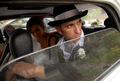 The young couple in the car Stock Photos