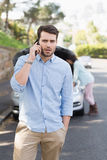 Young couple after a car breakdown Stock Image