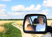 Young couple in car at countryside Royalty Free Stock Photos
