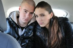 Young couple in car portrait Royalty Free Stock Photos