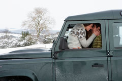 Young couple in car in snow Royalty Free Stock Photography