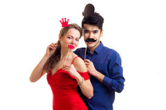 Young couple with cardboard sticks Stock Photo