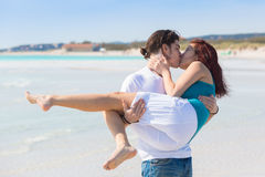 Young Couple in a Caribbean Beach Stock Image