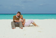 Young couple on caribbean beach on honeymoon Royalty Free Stock Photo