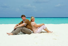 Young couple on caribbean beach on honeymoon Stock Photography