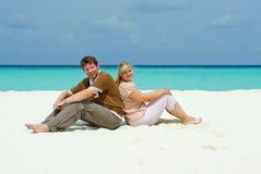 Young couple on caribbean beach on honeymoon Stock Photography