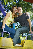Young couple on the carousel Stock Photos