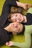 Young couple on the carpet Stock Photography