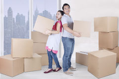 Young couple carry box in new apartment Stock Image