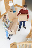 Young Couple Carrying Boxes On Moving In Day stock photography