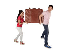 Young couple carrying baggage Royalty Free Stock Photography