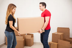 Young couple carrying a box Stock Photo