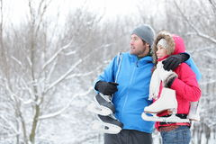 Young couple carrying ice skates Royalty Free Stock Image