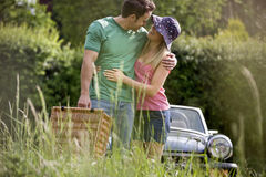 A young couple carrying a picnic basket in summertime Royalty Free Stock Photography